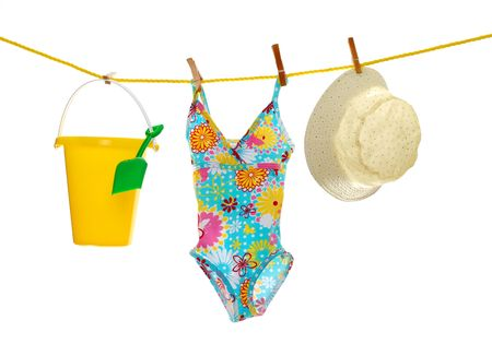 girls beach wear and toys on clothes line photo