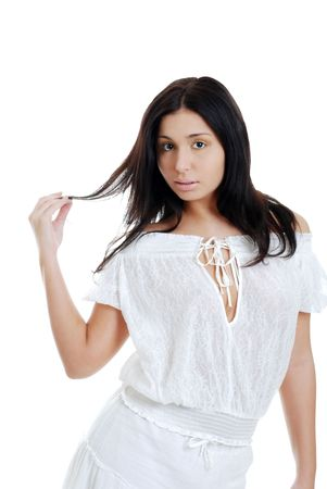 Hispanic woman playing with her hair photo