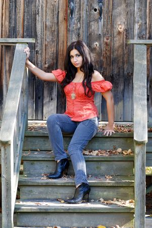 Hispanic woman sitting on wooden steps photo
