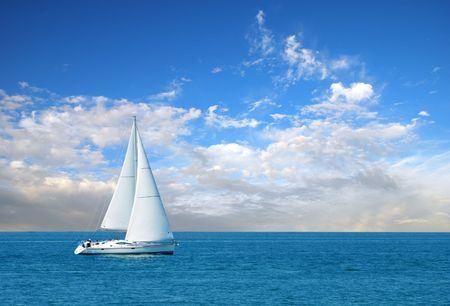 ocean waves: modern sail boat