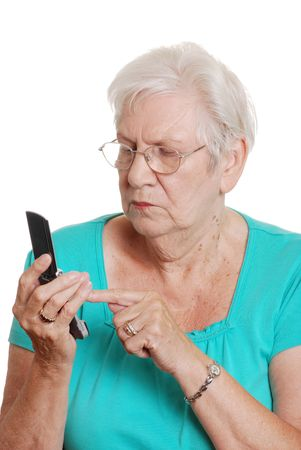 Senior woman dialing a number on cellphone Stock Photo - 5672410