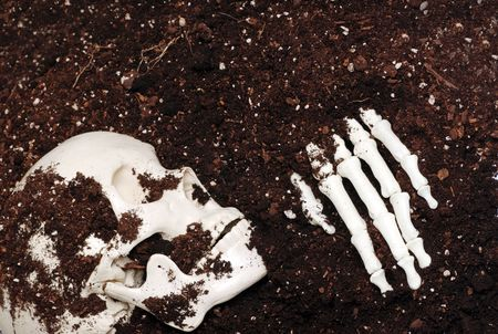 clawing: skeleton in dirt Stock Photo