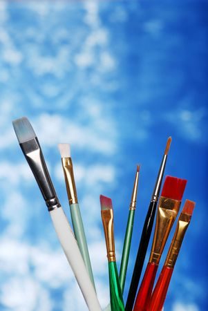 paint brushes on a blue and white background