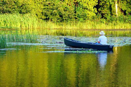 green boat: Fishing in Canoe