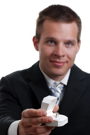 Isolated young man presenting engagement ring on a white background photo