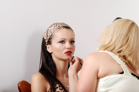 model getting red lipstick applied Stock Photo - 5693701