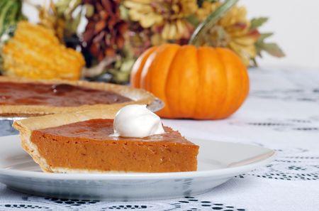 pumpkin pie and whip cream photo