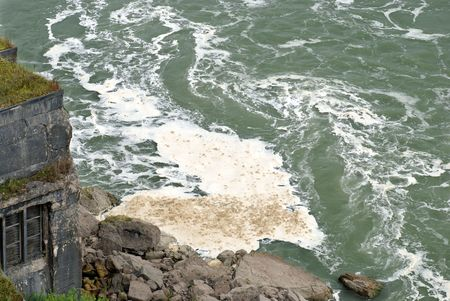 industrial park: water pollution with foam floating