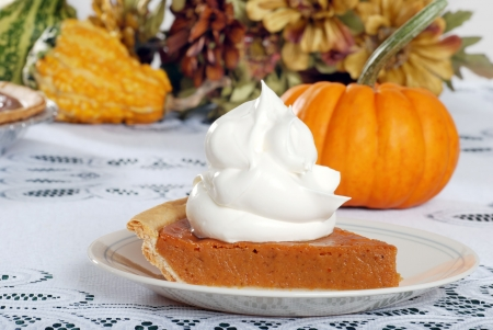 whipped cream loaded on pumpkin pie Stock Photo