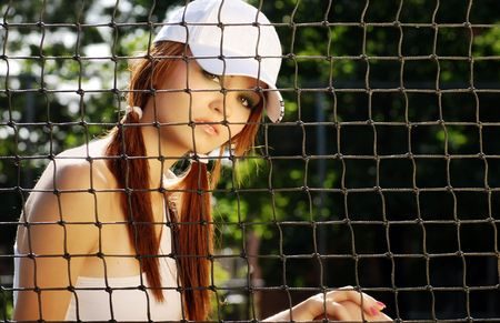woman tennis player sitting behind the net photo