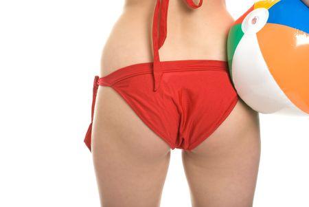 womans bottom in bikini holding beach ball