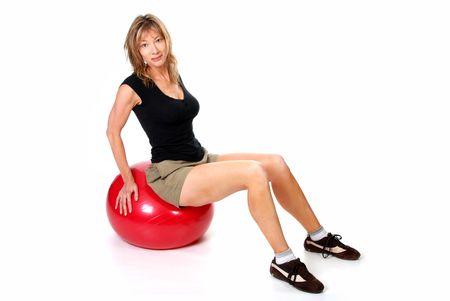 Women sitting on an excerise ball Stock Photo - 5693667
