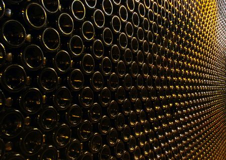 lots of wine bottles stacked photo