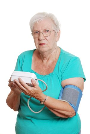 health concern: Senior woman use automatic blood pressure machine