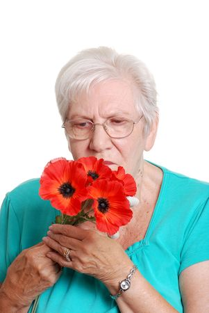 Senior woman with artificial red poppies
