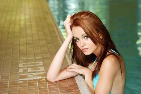 edge: sexy woman in a swimming pool Stock Photo