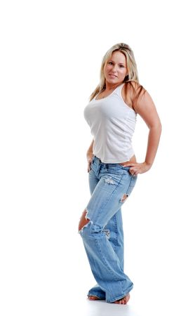 Sexy jonge vrouw met een gescheurde spijker broek  Stockfoto