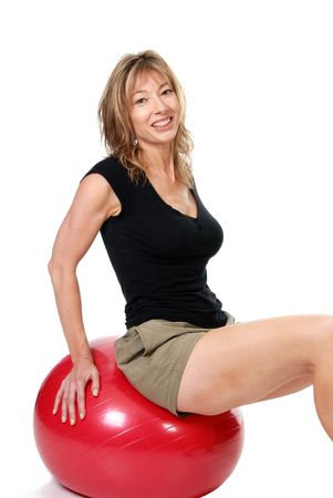Older women sitting on exercise ball photo