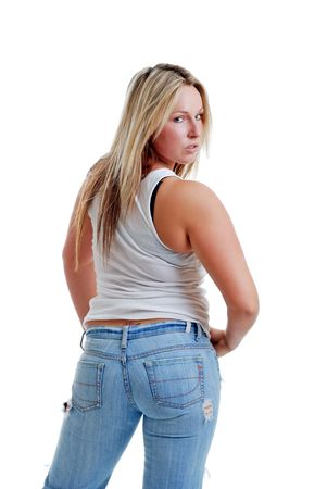 Sexy female in torn jeans looking over her shoulder photo