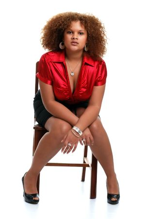 frizzy hair: young african woman posed on a chair
