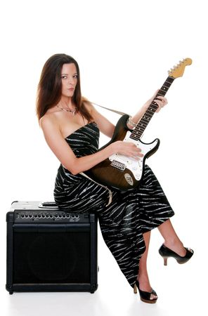 sexy brunette with a guitar photo