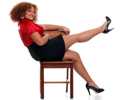 sexy african woman on a chair lifting her leg photo