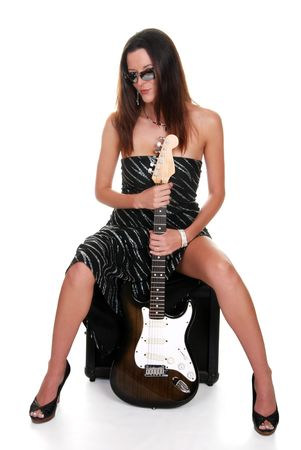 sexy brunette teasing and holding a guitar photo