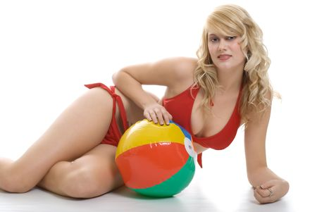 young blond in bikini laying with beach ball Stock Photo