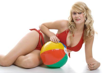 woman in bath: young blond in bikini laying with beach ball Stock Photo