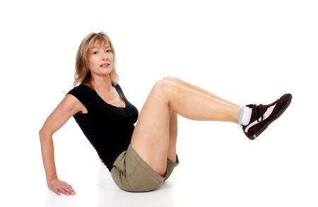 woman doing leg raise Stock Photo