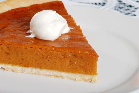 dessert topping on pumpkin pie focus on whip cream photo