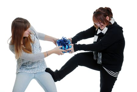 sisters fighting over a present Banque d'images