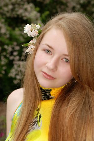 yellow: young female teenager with a flower in her hair Stock Photo