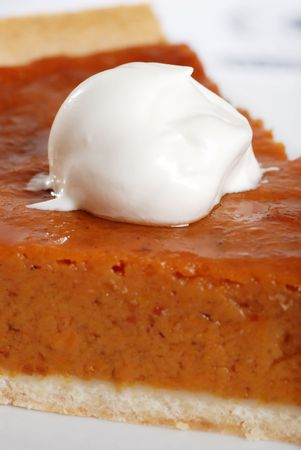 macro whip cream on pumpkin pie photo