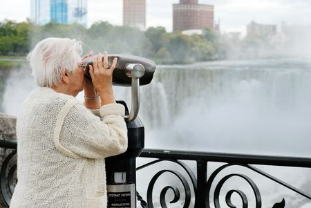 elderly woman looking at american falls in niagara Stock Photo - 5756620