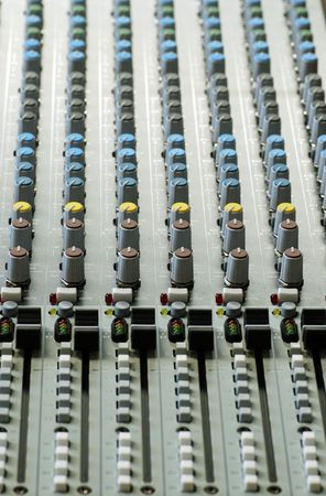 Sound board with focus on yellow and brown controls photo