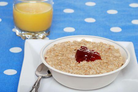 oatmeal with strawberry jam and orange juice photo