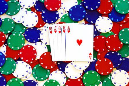 jacks: Royal Flush on a pile of poker chips