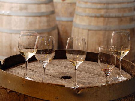 used wine glasses on an old wine barrel