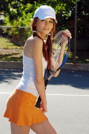 pig tails: young woman holding a tennis racket Stock Photo