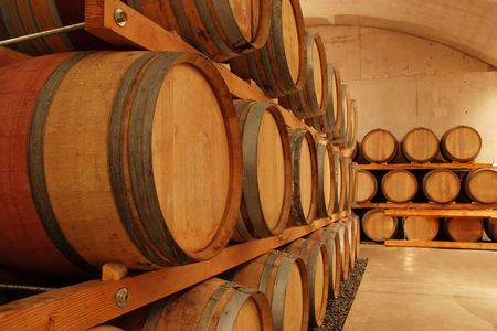 row of wine barrels in an old cellar photo