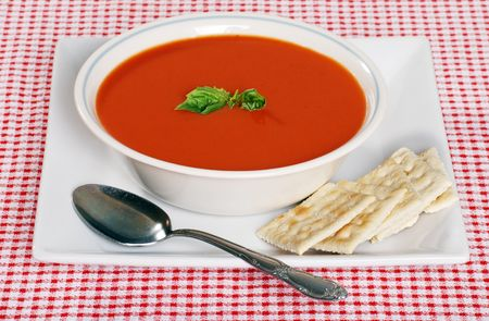 tomato soup in a bowl with basil photo