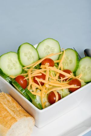 tossed salad with cheddar cheese with shallow Depth of field 스톡 콘텐츠