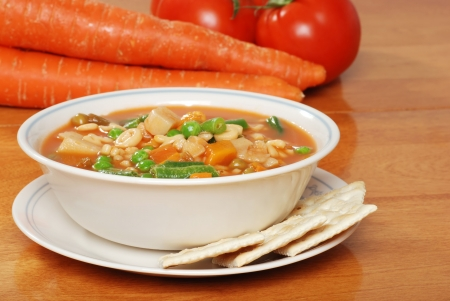 vegetable soup with crackers photo