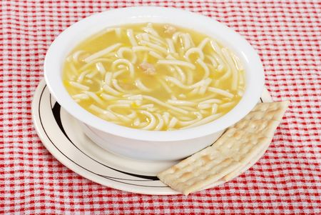 chicken noodle soup with salted crackers photo