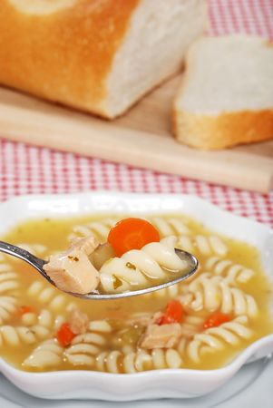 spoonful: Spoonful Of Chicken Pasta Soup Stock Photo