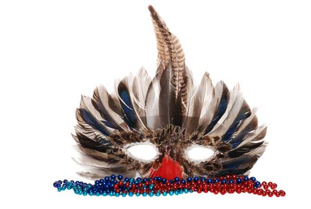 feather mardi gras mask with colorful beads photo