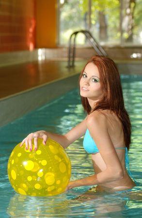 sexy woman having fun in swimming pool photo