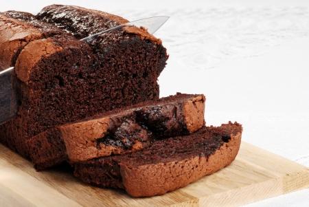 cutting slice belgium chocolate cake focus on knife tip photo