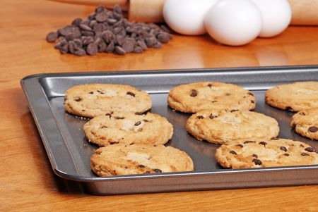 fresh baked cookies on a cookie sheet photo